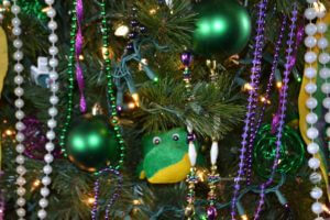 stuffed alligator in mardi gras tree up close