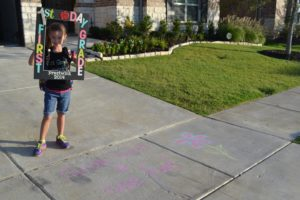 chalked driveway first day of school