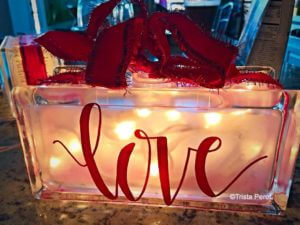 glass block love with red ribbon