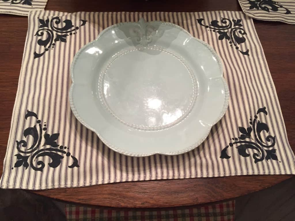 plain placesetting on french country placemats