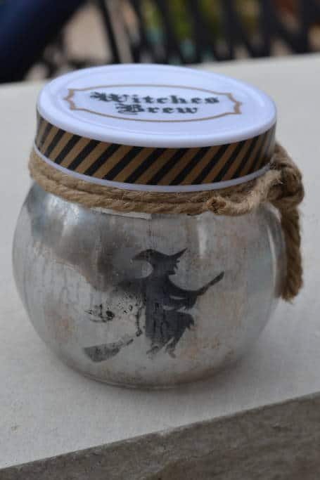 mercury glass looking witch luminary