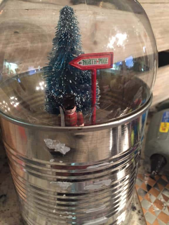 tin can to hold snow globe ornament